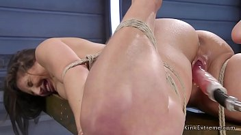 Tied up babe has fun on fucking machine