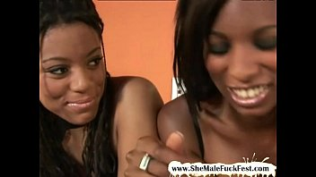 Black shemale babe shares a large white cock with her busty friend