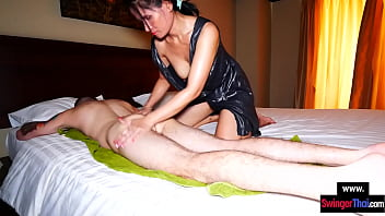 CoverAmateur MILF gives a Thai massage with happy end to her big cock customer