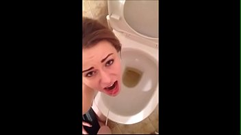 Hot girl drinking pee from cock in the toilet