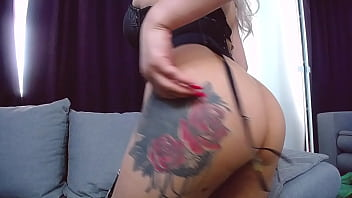 young girl with big breasts, red lipstick, big ass and a sexy black outfit