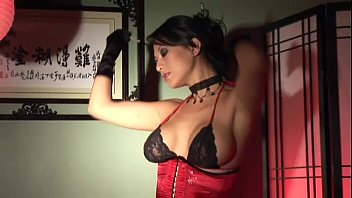 Masturbating in stockings gloves and a corset