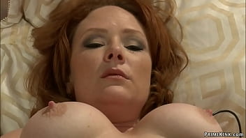 Redhead MILF takes machine in the ass