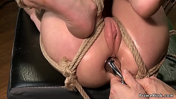 Petite slave takes fat head sex toy in ass