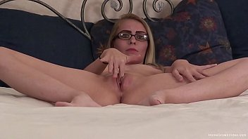 Skinny blonde masturbates with her fingers and a toy