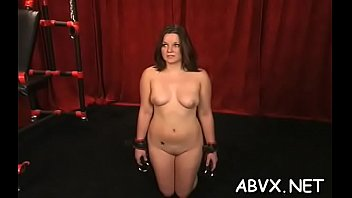 Nude woman stands and endures rough slavery amateur