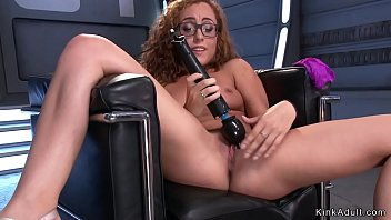 Curly redhead fucks machine and cums