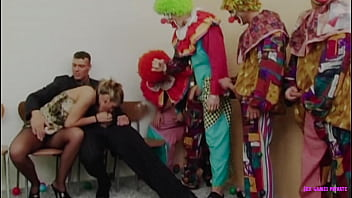 Husband invites group of clowns for his horny wife thumbnail