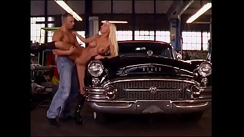 Hot MILF slut with cyrly hair and big boobs Sandra Blond gets her cunt fucked on the bonned