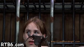 Gagged beauty's cunt is being drilled viciously by hard wang