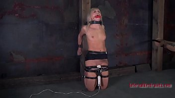 Tied up girl waits with fear for her next sexy punishment
