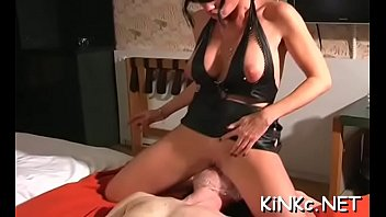 Nasty domme smothers serf and tortures with electricity