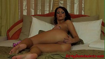 Dominant babe teasing with toys and dildo