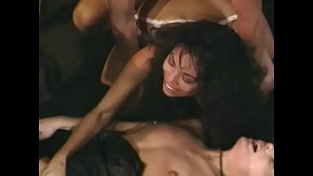Beautiful chicks fuck in different positions with muscle dudes in a retro 80s orgy