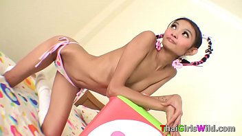 Super skinny Asian teen babe posing on bed