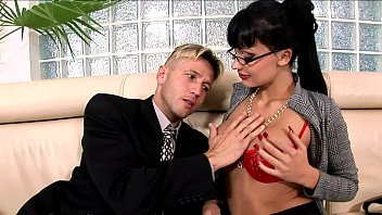 Horny secretary fucked on a couch in lingerie