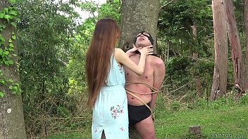 Mistress Risa trains a masochistic man in the outdoors