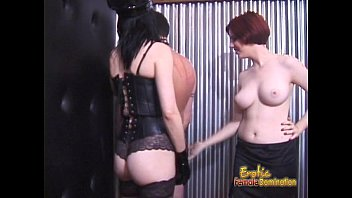 Horny stallion receives a proper caning from his hot brunette dominatrix