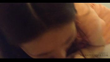 Cute Asian teen girl is sucking cock in a hotel (amateur)