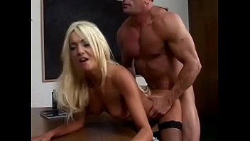 Blonde Donna Doll gets a big cock in her ass in the office