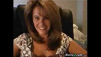 Sexy milf reveals her tits and ass for a while