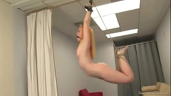 Enslaved teen is ballgagged, hogtied and suspended from ceiling like decoration