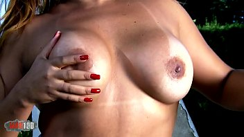 Horny mature with big tits Perla Berne removing clothes in the jungle