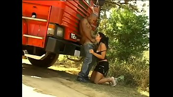 Muscular driver fucks a naughty brunette with a cool ass in a dog position near his truck