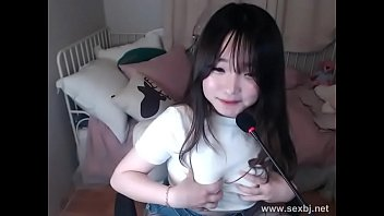 Korean girl masturbates on cam thumbnail
