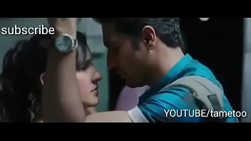 Indian boy and girl kissing in the morning Mumbai local train first time