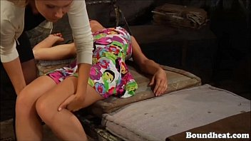 Lesbian slave upacked from a suitcase