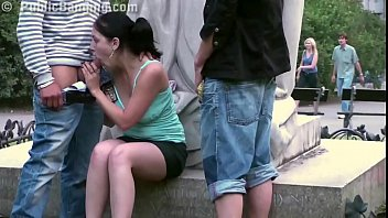 Young cute teen girl public street sex gang bang threesome by a famous statue