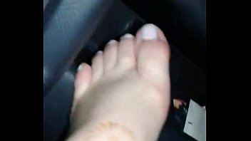 sexy amateur masturbates in a moving car and shows her sexy feet
