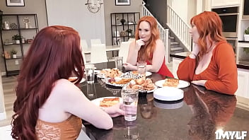 Three gorgeous red-headed ladies playing footsies with Quinton