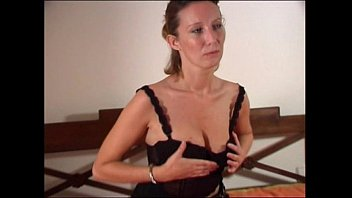 Bonde MILF stripping and touching herself on a bed