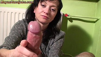 Mature Maya woman rubs cock until ejaculation