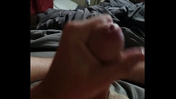 Squeezing out a big load while watching some porn