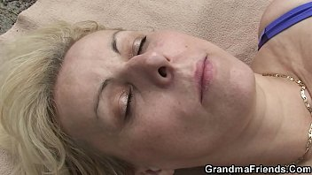 Blonde granny double penetration on the beach