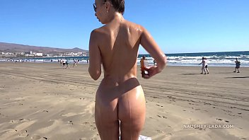 Oiling nude in the beach