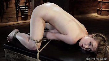 Blonde in bondage on knees whipped
