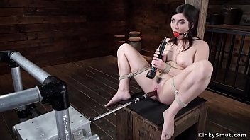 Gagged and bound sub is machine fucked
