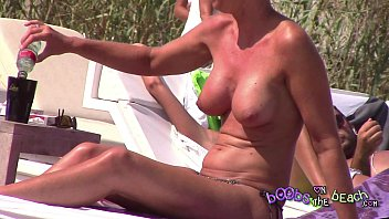 Posh Blonde Big Fake MILF Tits on the topless beach perving on the Italian Men