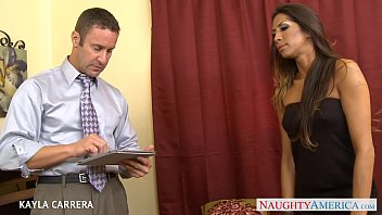 Tattooed Kayla Carrera takes a large dick