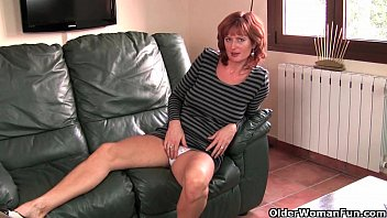 Naughty british mom porn British mature liddy masturbates on the couch