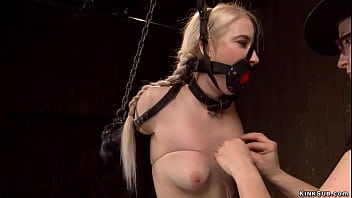 Blonde with limbs in latex is chained