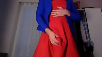 Young amateur cross dresser teasing and touching in a sexy red dress and cute blue blazer back from the office