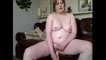 RUSTY AMATEUR REDHEAD REAL HOUSEWIFE EXPOSED ON HER COUCH STRIPING TAKES 12' VIBRATOR