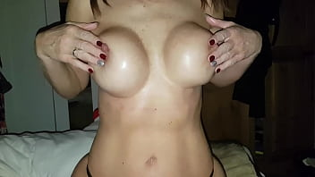 Playing with oiled breasts