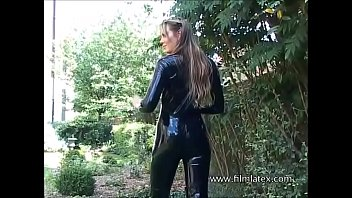 Sexy glamour babe Ellis outdoor latex fetish and sfw softcore beauty in high heel boots and tight rubber latexsuit outside