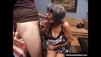 Rather than asking politely for a blowjob, muscular stud just grabs this granny by the hair and slips cock down her throat